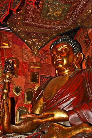 Estatua buda sentado café teatro Baeza